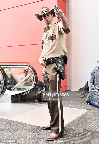 Comic Con attendee poses as Rick Grimes from The Walking Dead during the 2014 New York Comic Con at Jacob Javitz Center on October 11 2014 in New...