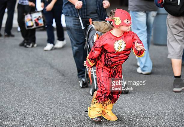 Comic Con attendee poses as the Flash during the 2016 New York Comic Con Day 2 on October 7 2016 in New York City