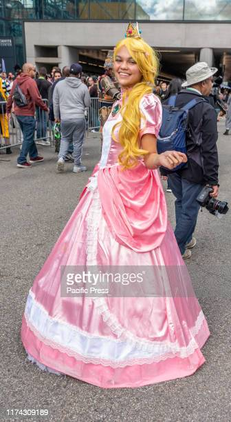 Comic Con attendee poses in the costumes during Comic Con 2019 at The Jacob K Javits Convention Center in New York City