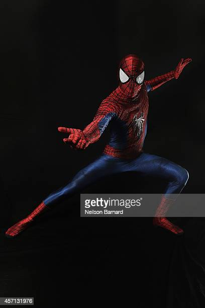 Comic Con attendee Shawn Webber poses as Spiderman during the 2014 New York Comic Con at Jacob Javitz Center on October 12, 2014 in New York City.