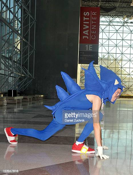 Comic Con attendee wearing a Sonic the Hedgehog costume poses during the 2012 New York Comic Con at the Javits Center on October 11 2012 in New York...