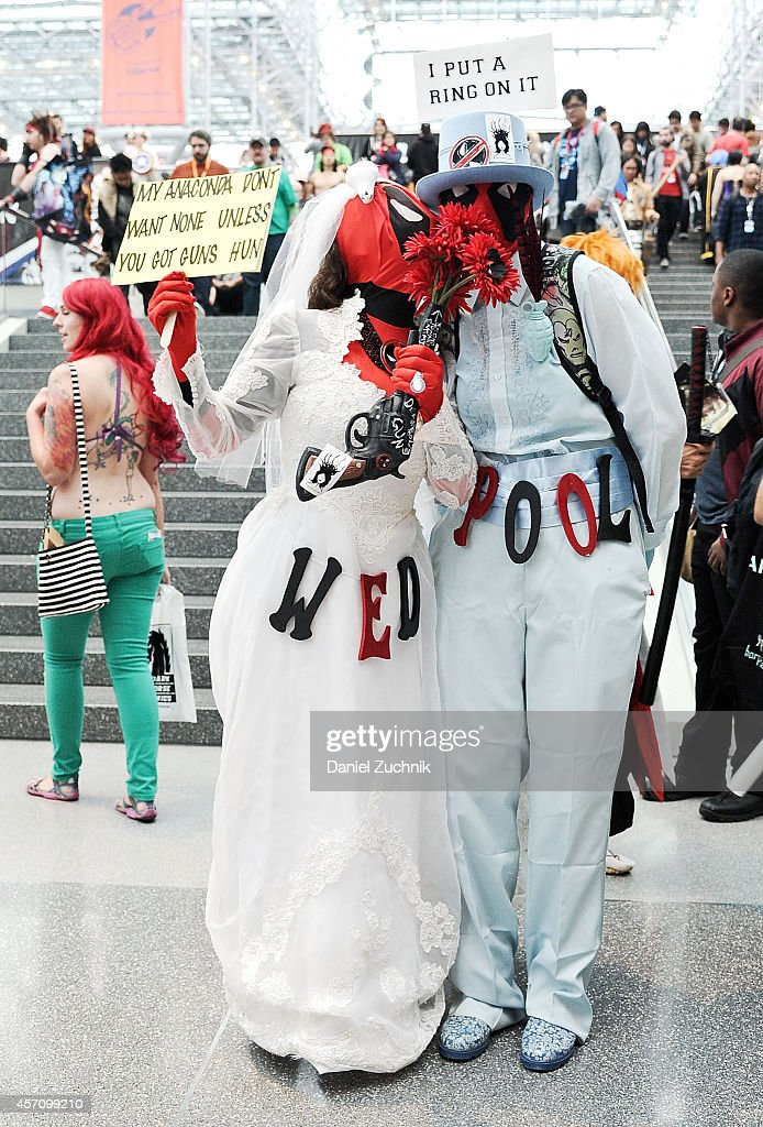 Comic Con attendees pose as Deadpool during the 2014 New York Comic Con at Jacob Javitz Center on October 11, 2014 in New York City.