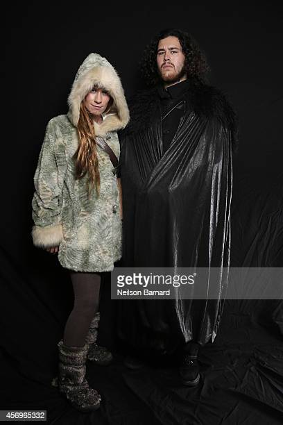 Comic Con attendees pose as Egret and John Snow from Game of Thrones during the 2014 New York Comic Con at Jacob Javitz Center on October 9 2014 in...
