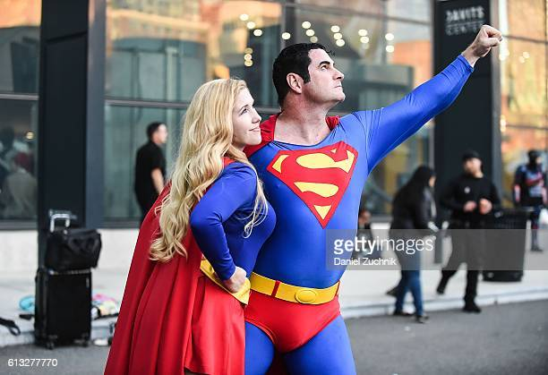 Comic Con attendees pose as Supergirl and Superman during the 2016 New York Comic Con Day 2 on October 7 2016 in New York City