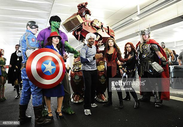 Comic Con attendees pose as the Avengers during New York ComicCon 2015 at The Jacob K Javits Convention Center on October 9 2015 in New York City