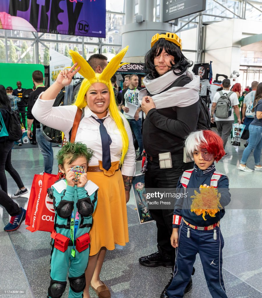 Comic Con attendees pose in the costumes during Comic Con... : News Photo