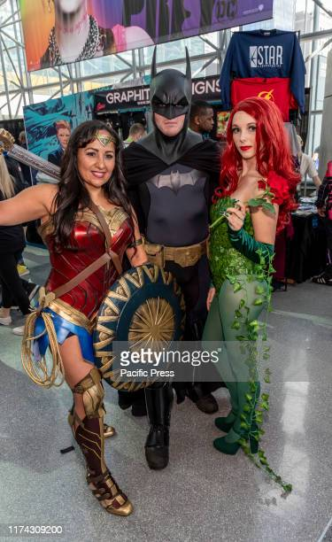 Comic Con attendees pose in the costumes during Comic Con 2019 at The Jacob K Javits Convention Center in New York City