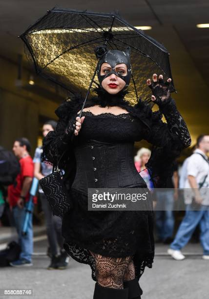 Comic Con cosplayer dressed as Catwoman poses during 2017 New York Comic Con Day 1 on October 5 2017 in New York City
