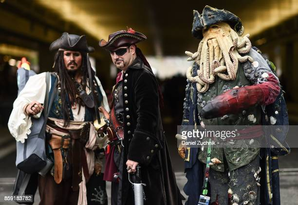Comic Con cosplayers dressed as characters from 'Pirates of the Caribbean' pose during the 2017 New York Comic Con Day 4 on October 8 2017 in New...