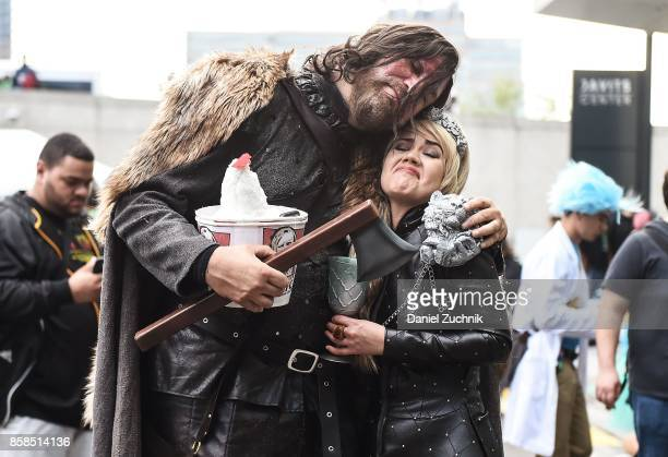 Comic Con cosplayers dressed as the Hound and Cersei Lannister pose during the 2017 New York Comic Con Day 2 on October 6 2017 in New York City