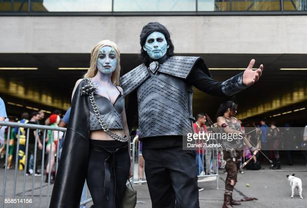 Comic Con cosplayers dressed as White Walkers pose during the 2017 New York Comic Con Day 2 on October 6 2017 in New York City