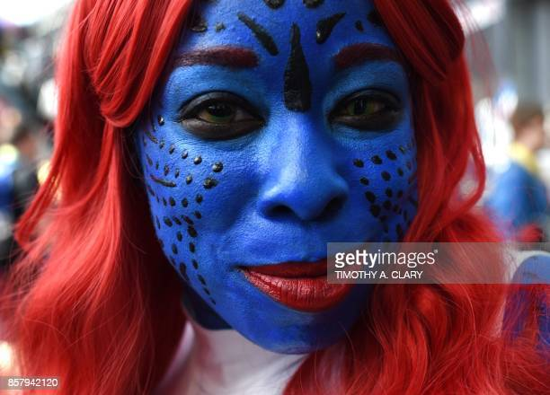 Comic Con fans in costume arrive for the 1st day of the 2017 New York Comic Con at the Jacob Javits Center on October 5 2017 in New York The fourday...