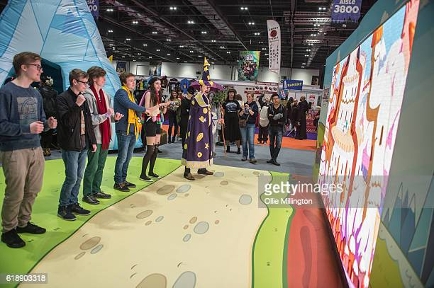 Comic fans play an interactive Adventure Time game during day 1 of the MCM London Comic Con at ExCel on October 28 2016 in London England
