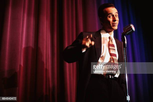 comic pointing to audience - comedian stock pictures, royalty-free photos & images