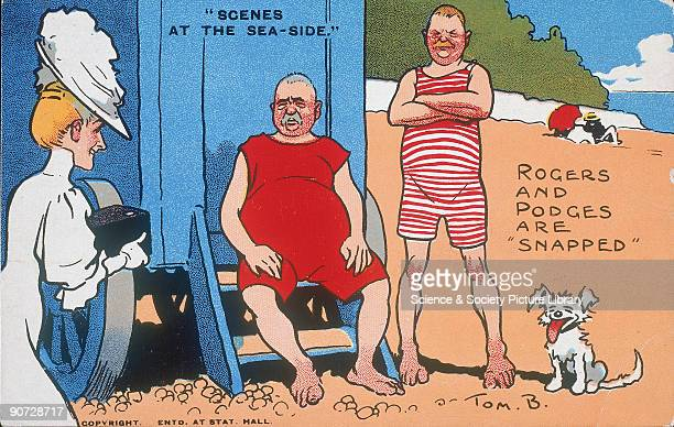 Comic postcard by Tom Browne showing a lady photographing two portly gentlemen in their swimming costumes