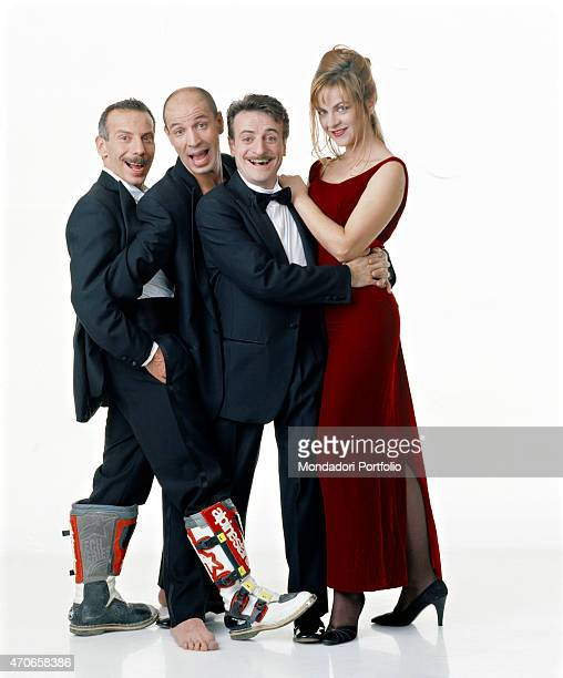 Comic trio Aldo Giovanni and Giacomo posing in a photo studio with actress Marina Massironi in a promotional shot for the movie Three Men and a Leg...