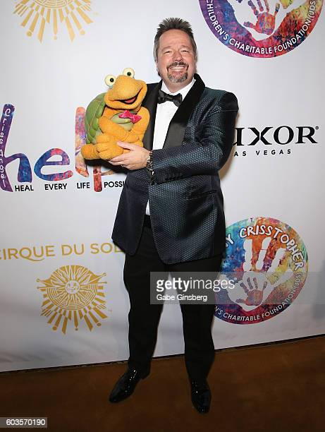 Comic ventriloquist and impressionist Terry Fator and Winston the Impersonating Turtle attend Criss Angel's HELP charity event at the Luxor Hotel and...