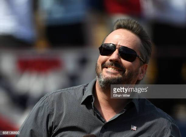 Comic ventriloquist and impressionist Terry Fator smiles after singing the American national anthem before an exhibition game between the Cincinnati...