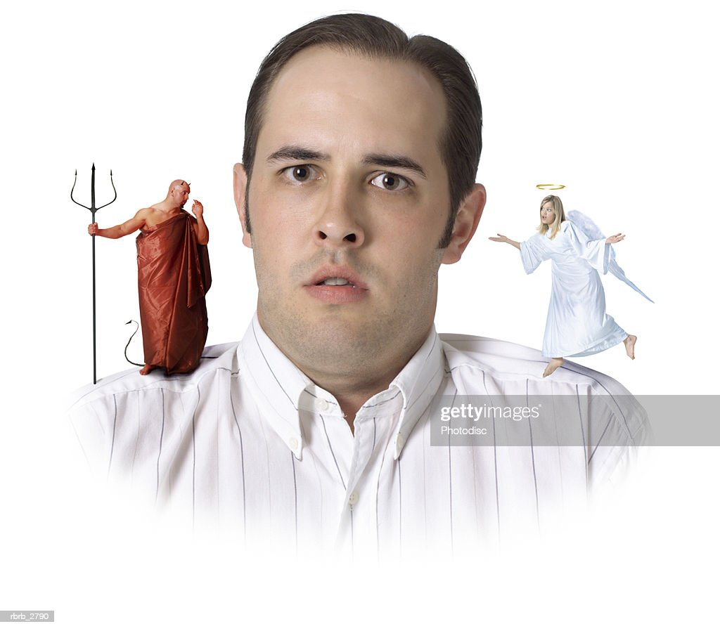 comical conceptual shot of a male getting advice from both an angel and a devil : Foto de stock