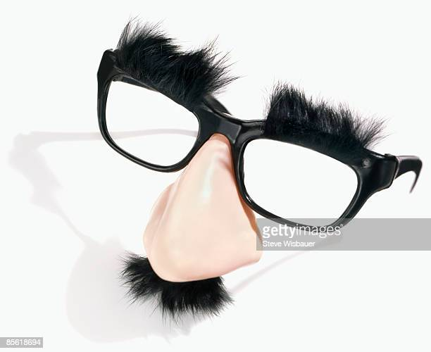 comical fake party nose and glasses disguise - groucho marx stock photos and pictures