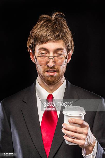 Comical Nerdy Businessman on Black Background, Holding Coffee