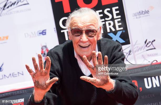 Comicbook writer editor and publisher Stan Lee places his hands in cement during his hand and footprint ceremony at TCL Chinese Theatre IMAX on July...