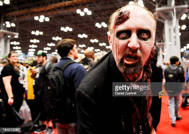 ComicCon attendee poses as a zombie at New York Comic Con 2013 at Jacob Javits Center on October 10 2013 in New York City