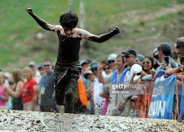 Michael Imhof, 10-years-old from Vail Colorado, crosses the mud pit during the family division Mud Run at the 10th annual Teva Mountain Games in Vail...