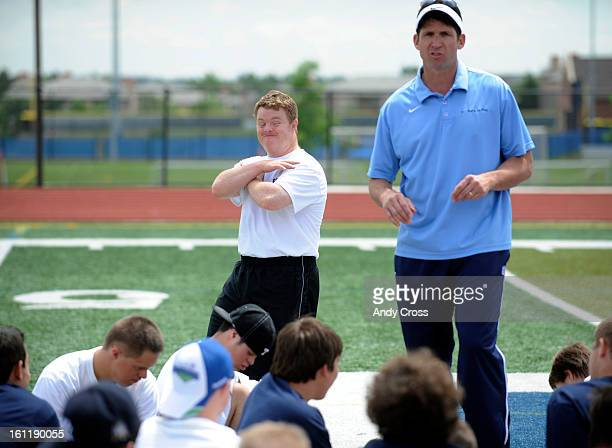 RANCH COMike Hazlehurst 32yearsold with Down Syndrome left motions along side of former Denver Bronco Ed McCaffrey during a pep talk after football...