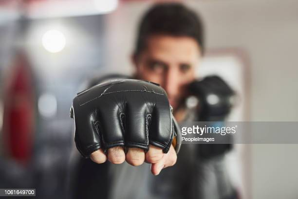 coming at you full force - mixed martial arts stock pictures, royalty-free photos & images
