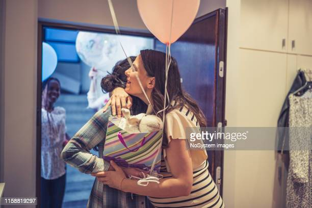coming in to baby shower party - baby shower stock pictures, royalty-free photos & images