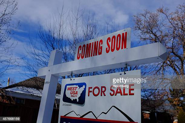A Coming Soon For Sale sign stands in the yard of a single family home in Denver Colorado US on Friday Dec 13 2013 The National Association of...