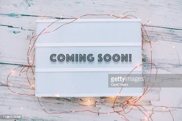 """""""coming soon"""" message in light box - coming soon stock pictures, royalty-free photos & images"""