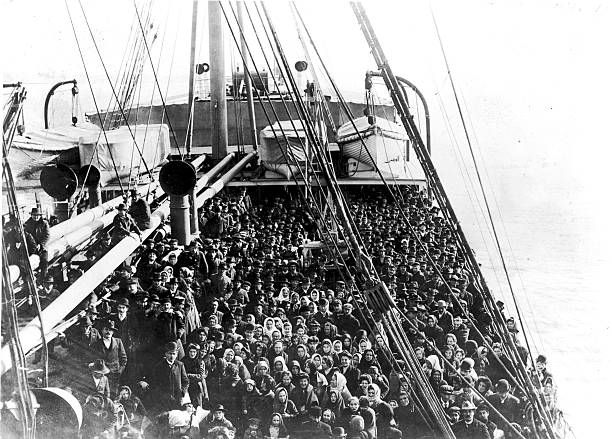 Immigrants pack the upper deck of the liner SS Patricia...
