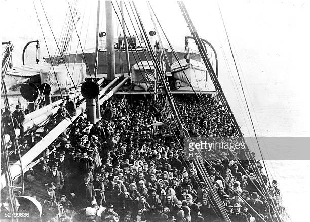 Immigrants pack the upper deck of the liner SS Patricia as it travels from Hamburg to New York December 10 1906 The Patricia was built by AG Vulcan...