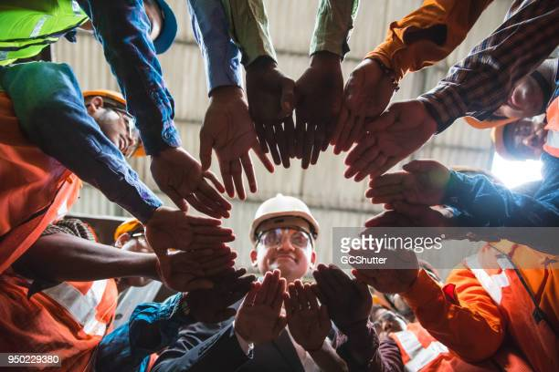 coming together in a circle for unity - safety stock pictures, royalty-free photos & images