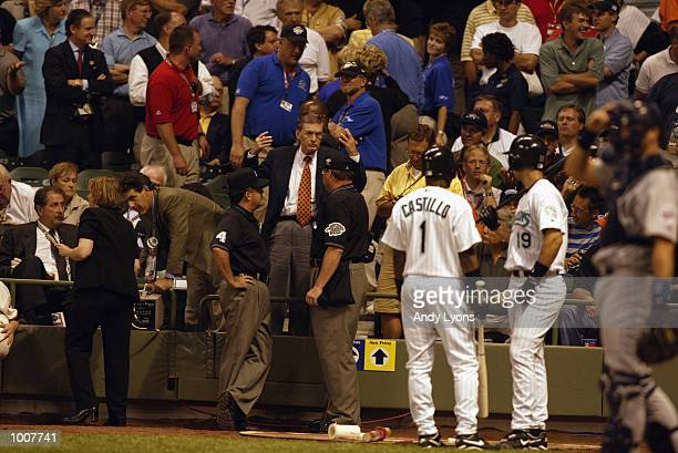 Comissioner Bud Selig confers with the game umpires in the 11th inning during the MLB All Star Game July 9 2002 at Miller Park in Milwaukee Wisconsin...