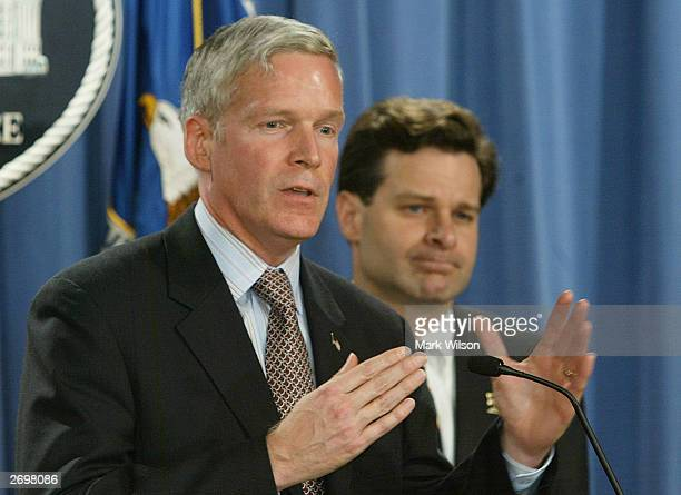 Comissioner Marc Everson and Assistant US Attorney General Christopher Wray speak at the Justice Department on November 4 2003 in Washington DC Wray...