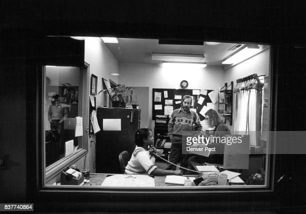 Comitis Telephone Hot Line Room Where Crisis Calls Come In Phone in hand Terri Bradshaw program coordinator standing DB Lawson Asst Director Anne...