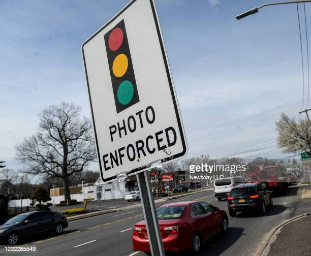 A traffic sign reads photo enforced to warn of a red light camera at Indian Head Rd and Jericho Tpke in Commack New York on April 11 2016
