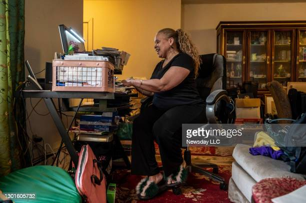 Commack resident Deborah Cuevas-Cherry wears casual clothes and fuzzy slippers while working at her Con Edison job from her Commack, New York home on...