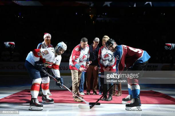 Command Sergeant Major Joseph W Bishop drops the ceremonial puck next to his wife Kay two sons Lance and Sergeant First Class Joseph Bishop Jr his...