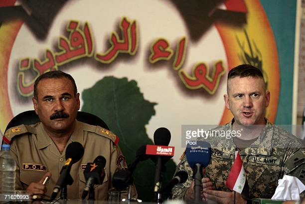 US commander Colonel Michael F Beech 4th brigade combat team 4th infantry division speaks during a joint press conference with Iraqi BG Abdel Karim...