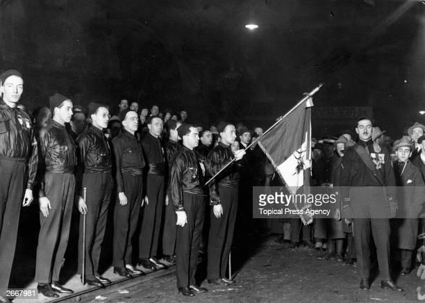 Commander D'Amelio Mario and the fascist guard prepare for the arrival of Benito Mussolini