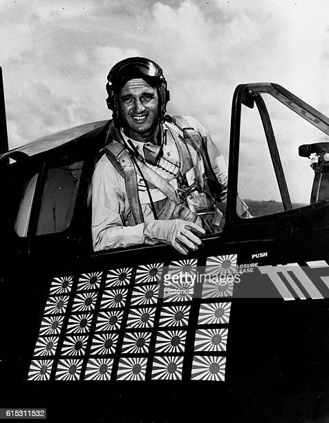 Commander David McCampbell USN in cockpit of F6F showing flags denoting his 30 Japanese planes shot down aboard USS Essex   Location cockpit of F6F...
