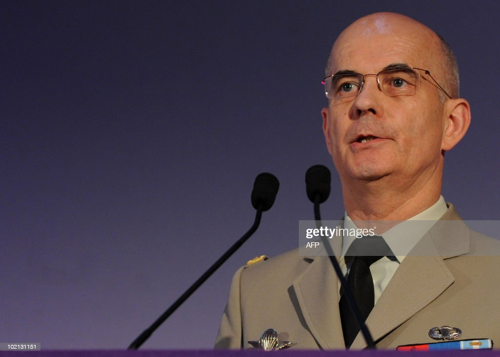 Commander, Force Employment and Doctrine Centre of the French Army Major General Thierry Ollivier delivers his key note address to the Land Warfare Conference, attended by Vice Chief of Staff of the US Army, General Peter W. Chiarelli, and Chief of the General Staff of the British Army, General Sir David Richards (both not pictured), at the Royal United Services Institute (RUSI), in London on June 8, 2010.