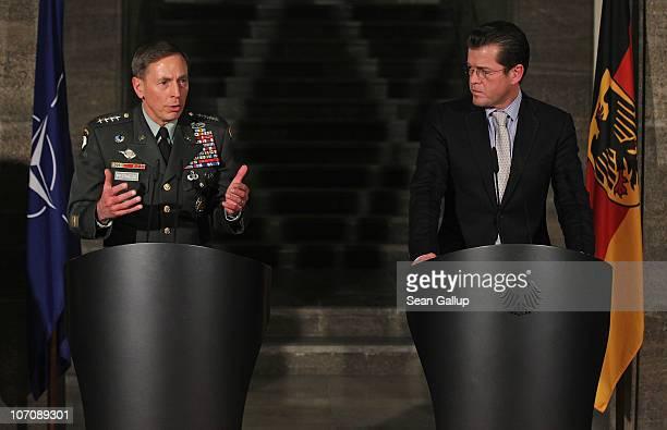 Commander General David Petraeus and German Defense Minister KarlTheodor zu Guttenberg speak to the media after talks on November 23 2010 in Berlin...