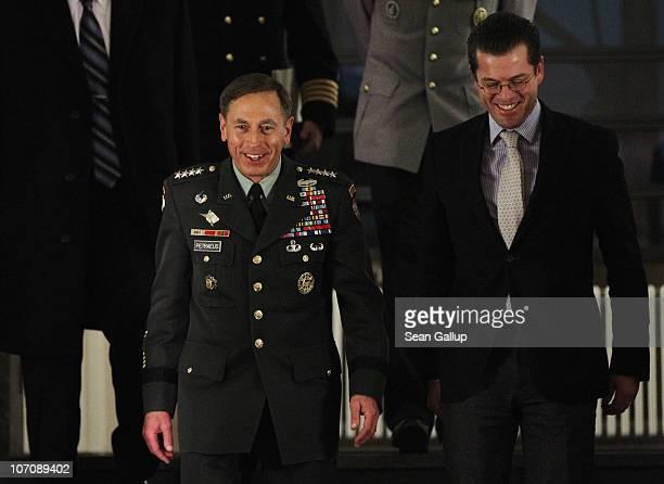Commander General David Petraeus and German Defense Minister KarlTheodor zu Guttenberg arrive to speak to the media after talks on November 23 2010...