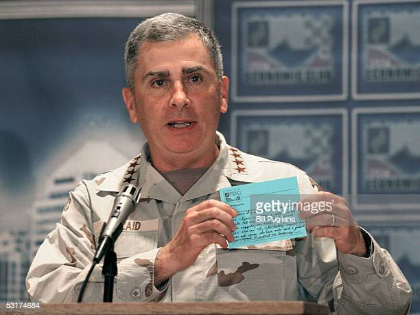Commander General John Abizaid holds up one of the cards that were given to the audience to allow them to ask him questions and he jokingly said...