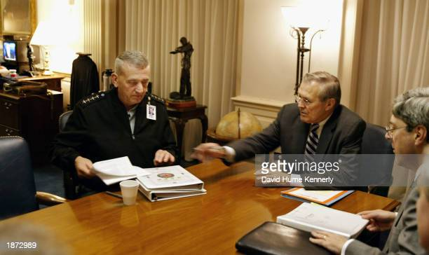 Commander General Tommy Franks meets with Secretary of Defense Donald Rumsfeld and U.S. Undersecretary of Policy at the Department of Defense Doug...